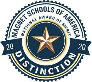 """A circular badge with a five-pointed gold star in the center. The top of the badge reads """"Magnet Schools of America: National Award of Merit"""", while the bottom reads """"Distinction 2020""""."""