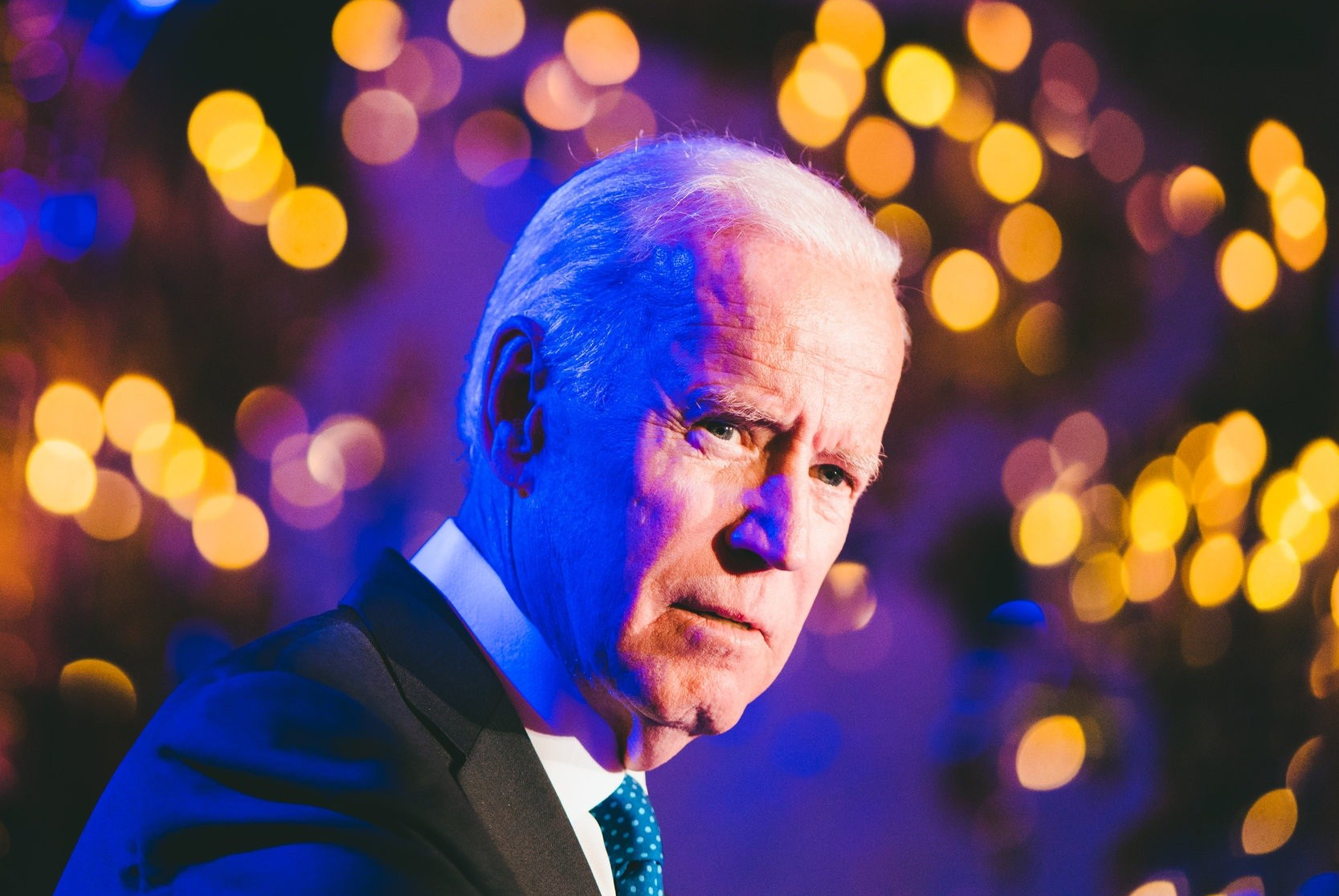 Joe Biden in front of a display of lights.